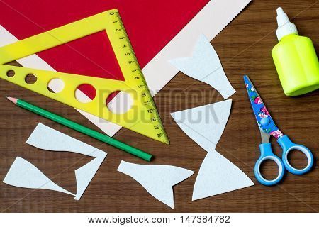 Making original bow in the form of Santa Claus for decoration Christmas gifts. Step by step photo instructions. Step 3. Cutting the details