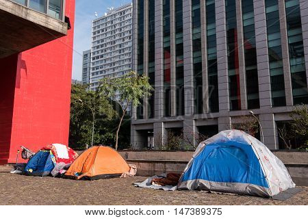 Sao Paulo, Brazil - June 26, 2016: Tents of homeless people behind the Museum of Art of Sao Paulo.