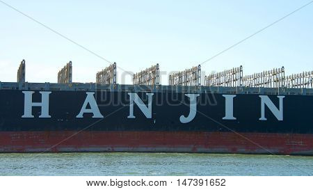 Oakland CA - September 15 2016: The first Hanjin vessel to dock at the Port of Oakland since Hanjin declared bankruptcy Hanjin GREECE departs with no visible cargo.