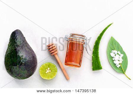 Alternative Skin Care And Scrub Fresh Avocado , Leaves ,sea Salt , Oils, Lime And Honey On Marble Ba