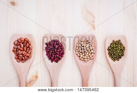 Assortment Of Beans And Lentils In Wooden Spoon On Wooden Background.  Soybean, Mung Bean , Red Bean