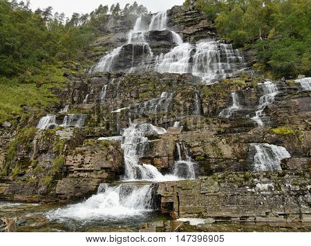 Waterfall Tvindefossen, Norway. Waterfall Tvindefossen is the largest and highest waterfall of Norway, it is famous for its beauty, its height is 152 m.