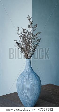 Dried bouquet flowers in ceramic vase with color filter effect