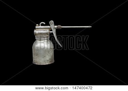 Old and dirty metal oil can isolated on black background