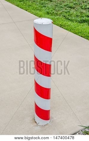 Red and white candy cane striped concrete barrier post in Santa Claus Indiana where it is Christmas all year long