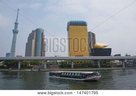 TOKYO  , JAPAN - MAY 2 , 2016 :  view of Sumida River with Tokyo Skytree and The Asahi Beer , Tokyo, Japan. MAY 2 2016.