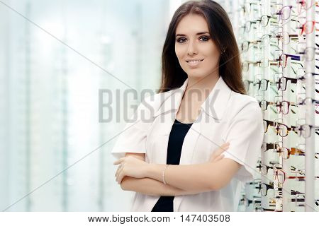 Happy Female Optician Standing in Optical Store