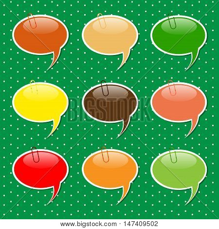 Speech Bubble paper sticker shapes with paper clips in warm autumn colors.