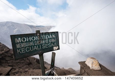 Volcano Mount Bromo, view from crater with warning sign board