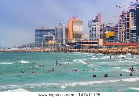 TEL AVIV, ISRAEL - August 24, 2016: view of the waterfront with modern luxury hotels, beach and surfers from old Jaffa on august 24, 2016 Tel Aviv, Israel