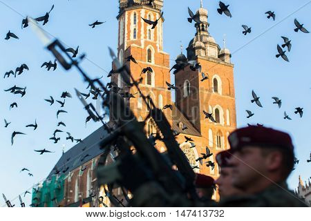 KRAKOW, POLAND - SEP 10, 2016: Polish soldiers on guard of the ceremony is the vow of first classes of the Jan III Sobieski High School (founded 1883) at the Main Market Square near St.Mary Cathedral.