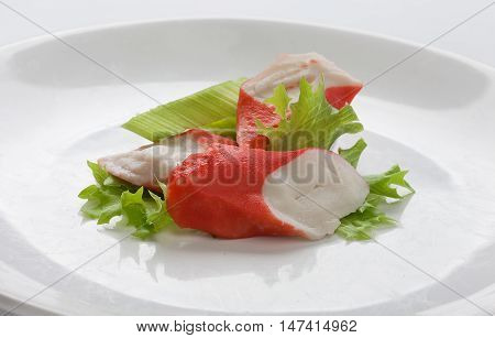 Crab meat with fresh green lettuce on the plate