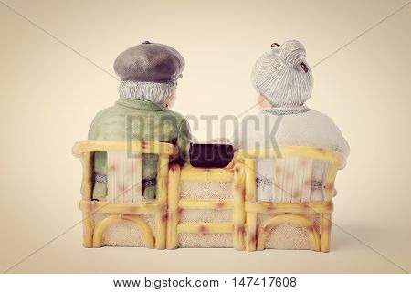 Lovely Grandparent Doll Siting Rocking Bamboo Chair Isolate On White Background