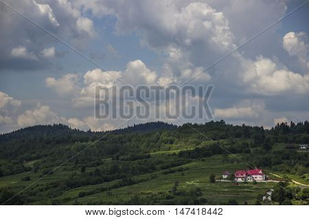 big cottage in the valley in the Ukrainian Carpathians