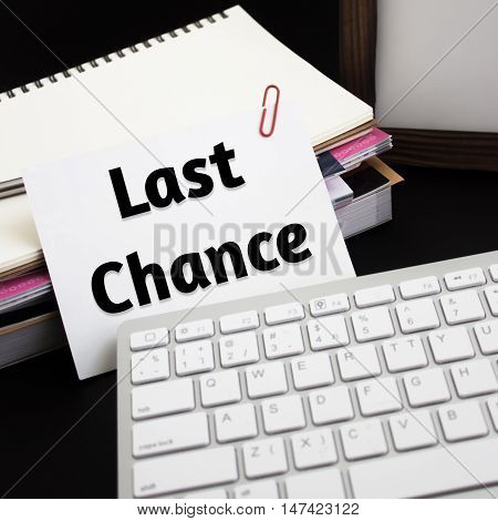 Word text Last chance on white paper card / business concept