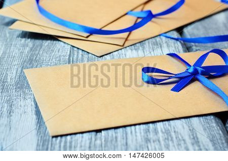 Gift envelope with blue ribbon. Kraft envelope