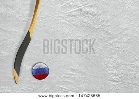 Hockey stick and puck on the ice Russian. Concept background