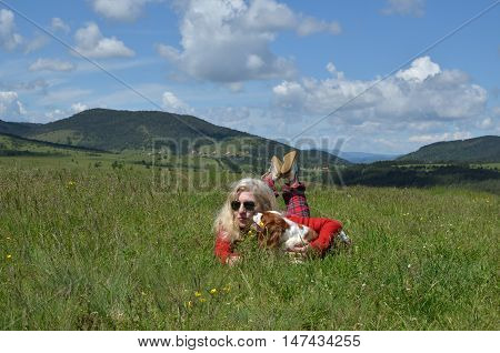 Woman And Dog On Meadow