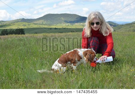 Woman Giving Water To Dog