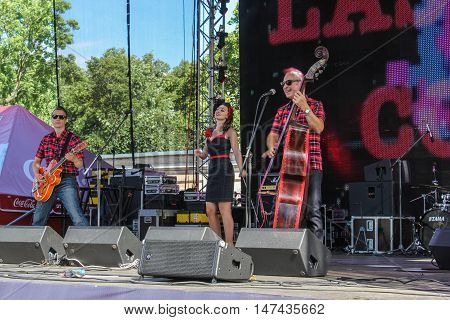 St. Petersburg, Russia - 12 August, Trio on stage,12 August, 2016. Pop and rock musicians on Harley Davidson festival in St. Petersburg.