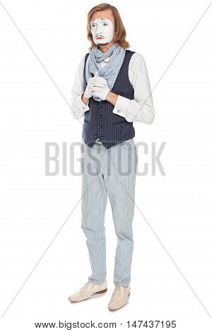 sad mime actor standing with folded arms
