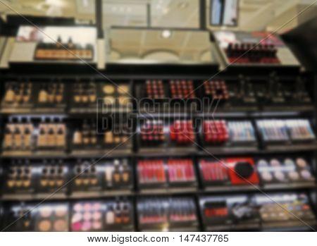 Decorative cosmetics on shelves in supermarket