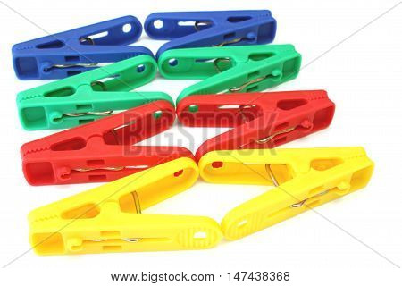 Group color clothespin isolated on a white background