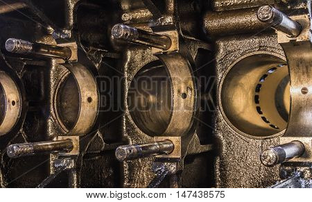 Close up of the inside of an internal combustion engine of a truck motor.