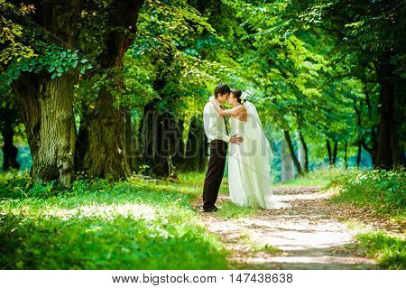 Happy Bride And Groom On A Walk In Beautiful Forest