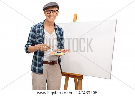 Mature painter posing next to a blank canvas isolated on white background