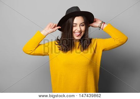 Street Style Hipster Girl at Grey Wall Background. Trendy Casual Fashion Outfit