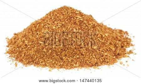 Close up of Crushed cumin over white background