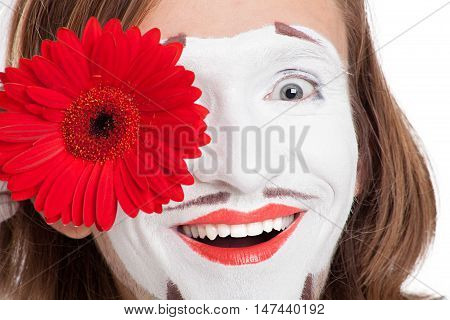 mime actor smiles attaching to face red flower