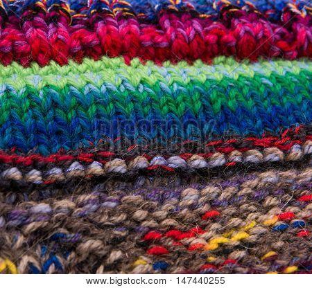 striped colorful wool texture handmade patten closeup macro blue red green yellow  biege purple orange brown