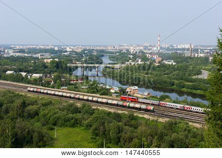 Beautiful cityscape of small town with river and railway in summer Ukhta Russia 19.07.2016