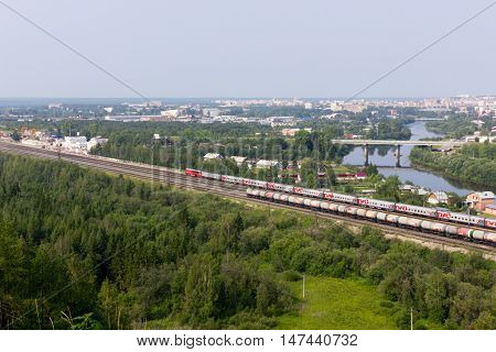 Beautiful cityscape of small town with river and railway in summer Uchta Russia 19.07.2016