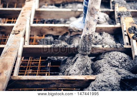Construction Worker Pouring Cement On Stairs, Creating Sidewalks And Stairs On New Building Site