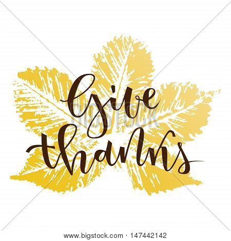 Give thanks hand lettering greeting with fall chestnut leaf on white background