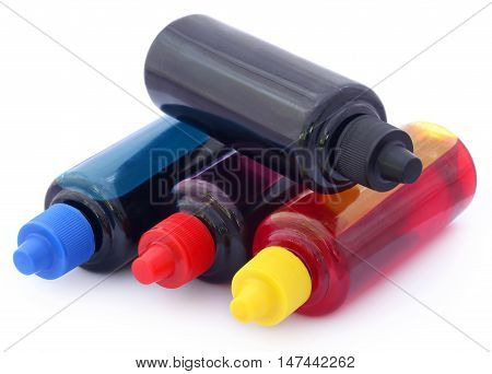 Close up of Printer ink bottles over white background