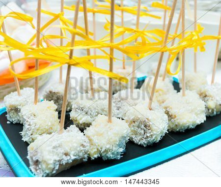 Banana pops with chocolate nuts coconut powder at Happy Birthday table