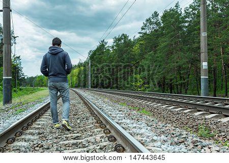 A man walking on the tracks railway