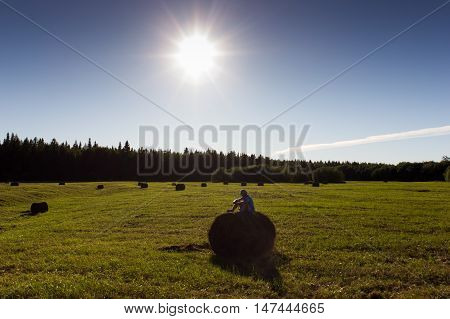 Rural Landscape With Boy And Haystacks