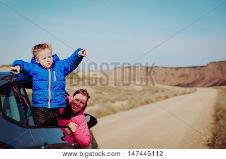 mother and son travel by car in mountains, family travel