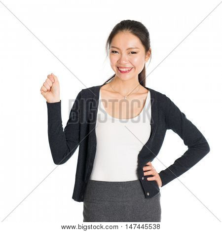 Portrait of young Asian woman hand grabbing something and smiling, isolated on white background.
