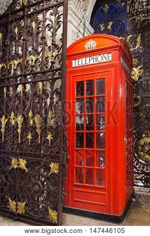 Popular Tourist Red Phone Booth In Night Lights Illumination In
