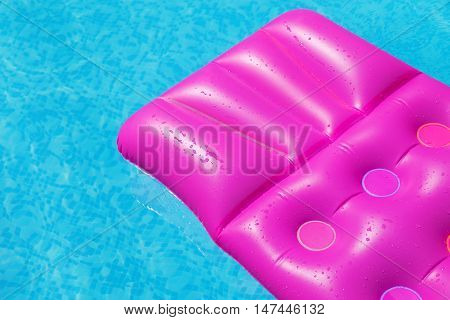 Pink Air Mattress On A Swimming Pool. Holiday Tropical Concept