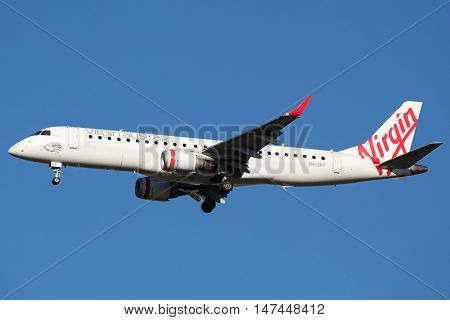BRISBANE, AUSTRALIA - June 30: A Virgin Australia Embraer E190 jet is seen arriving in to Brisbane, Australia, on Thursday, 30th June, 2016