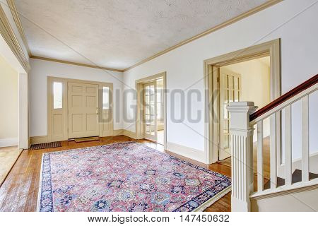 Hallway Interior In White Tones With Hardwood Floor And Rug.