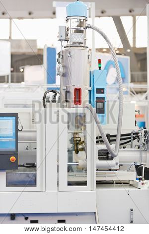 Injection moulding machine, color image, close up