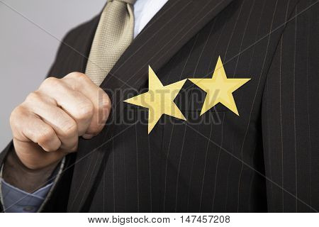 Extreme closeup of a businessman with  two gold stars on suit